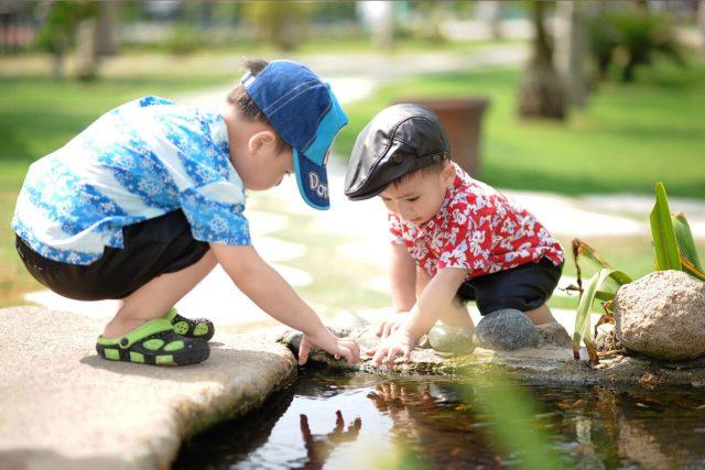Eye doctor, little boys playing outside in Winter Park, FL