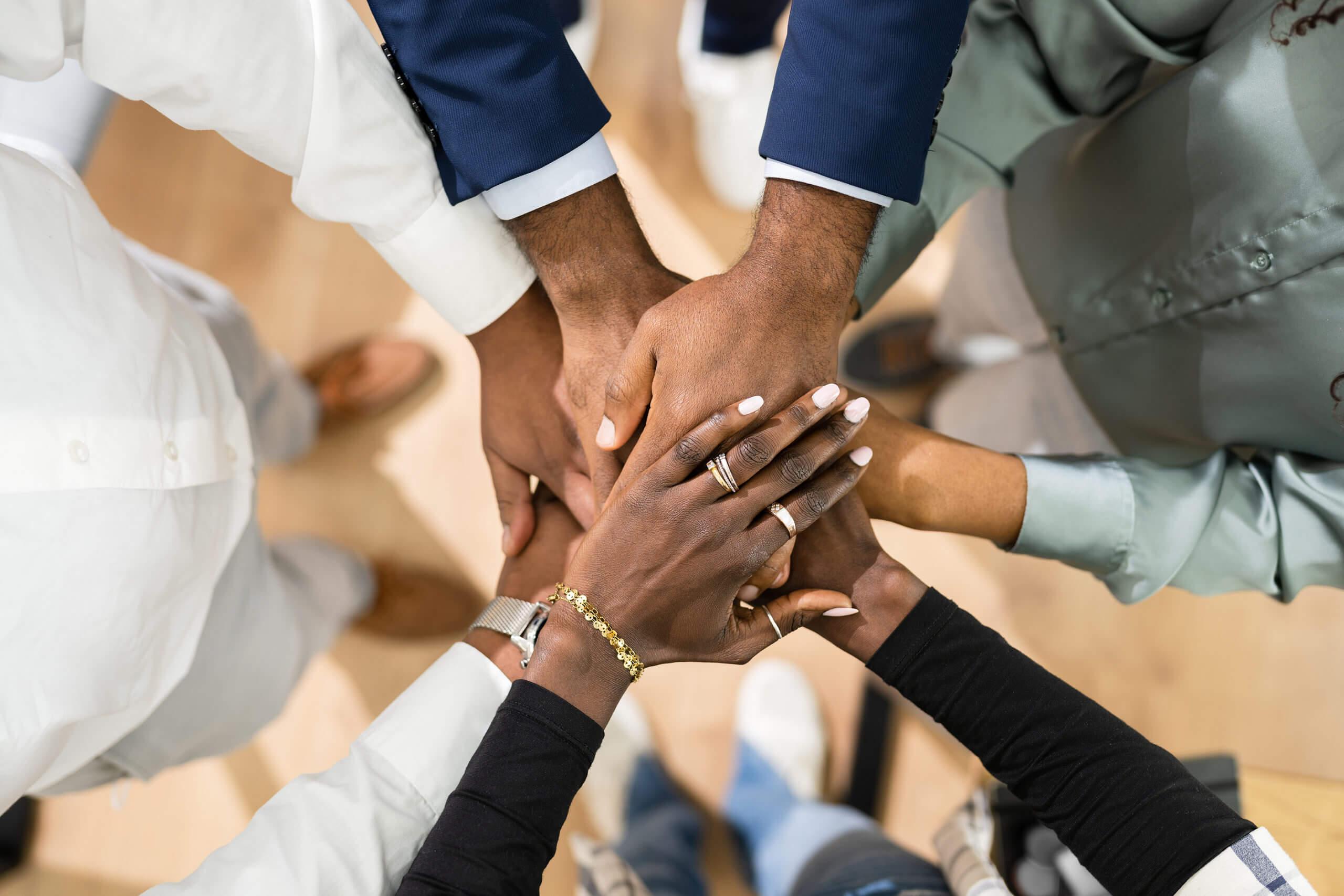 African Business Team Hands. Community Spirit Concept
