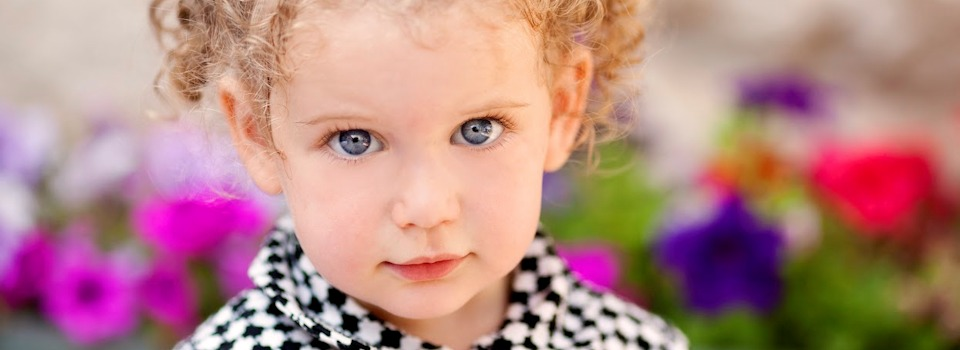 girl-with-blue-eyes-in-black-and-white-coat-slide