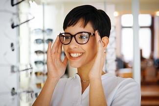 woman trying on eyeglasses 325x217
