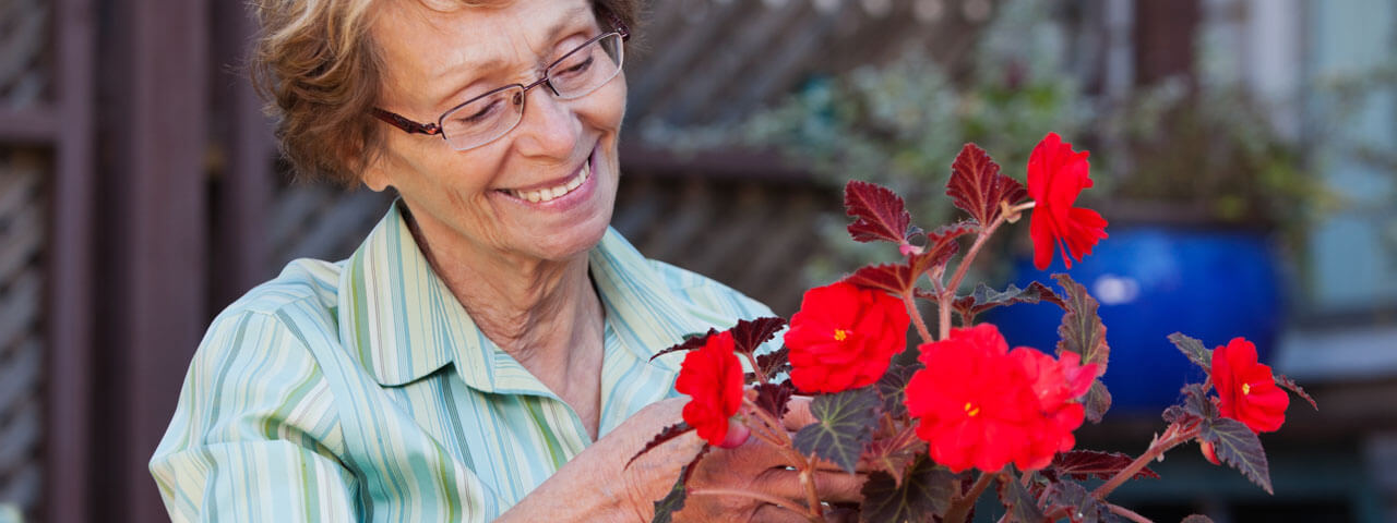 Older lady wearing glasses in Clay | Eye Care Services at Mondo Optical