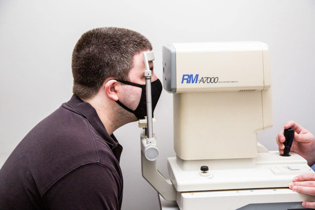Patient during an eye exam in Clay, New York