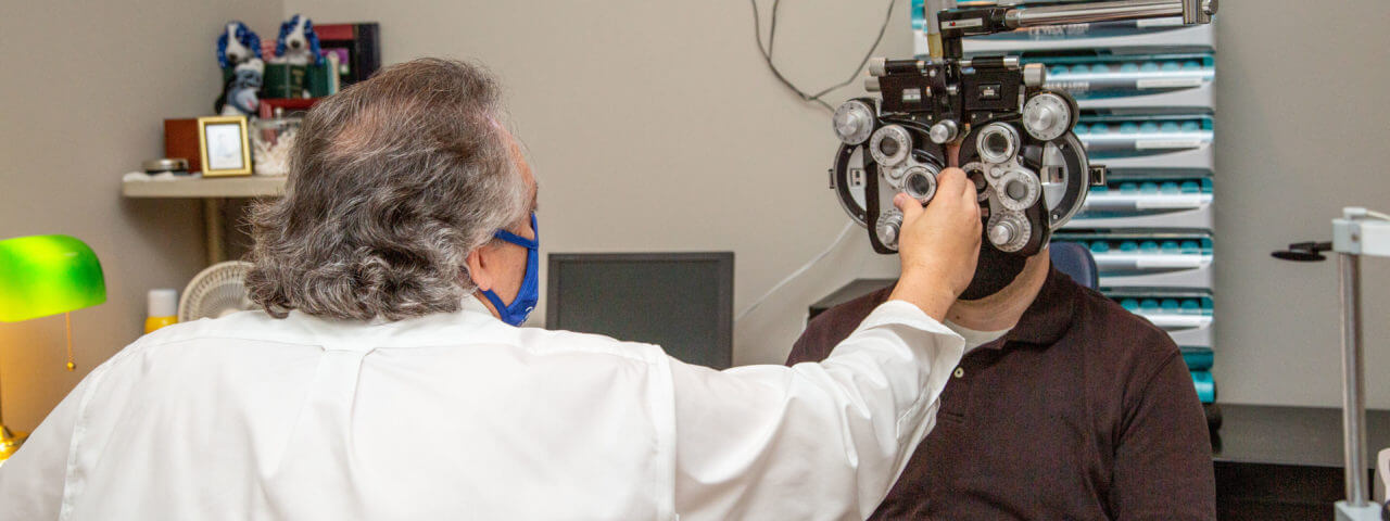 patient during an eye exam with our optometrist in Clay, New York