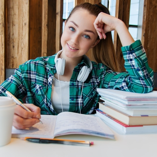 teen with contact lenses studying