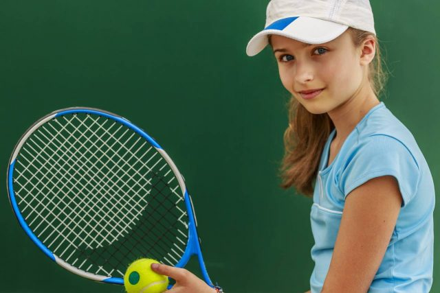 Girl playing tennis after Orth-k