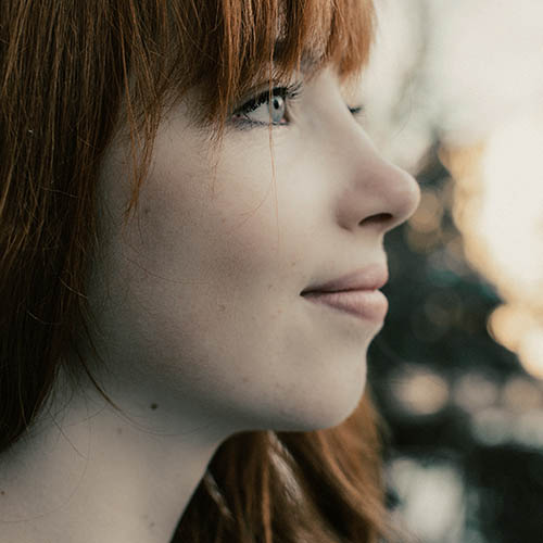 Lady with red hair, Eye Doctor in Orlando & Lake Mary, FL