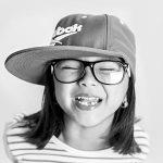 Optometrist, girl close her eyes with eyeglasses in Kelowna BC Eye Exam