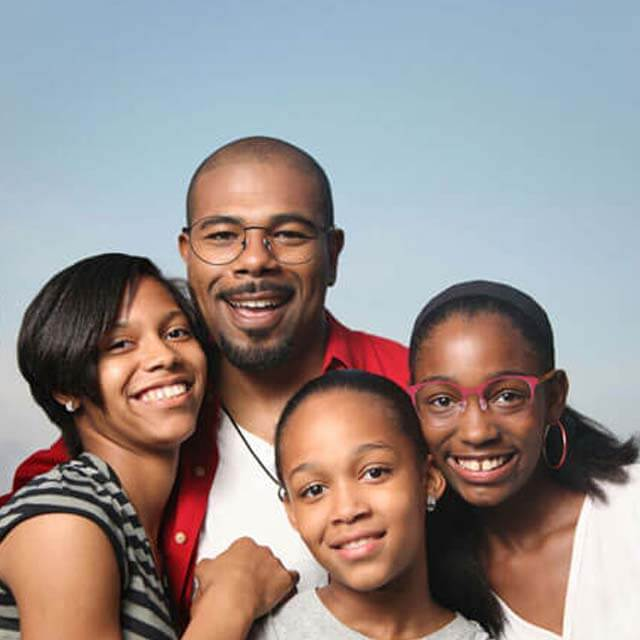 Happy family wearing glasses in Palmetto Bay