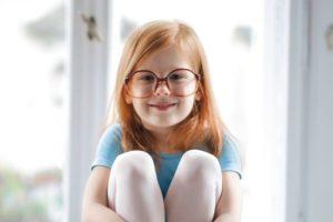 child girl redhead smiling glasses blue ballet dress e1611740044685.jpg
