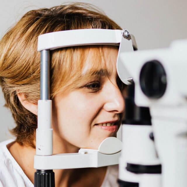 woman smiling laptop eyeglasses 1000 2 640x640