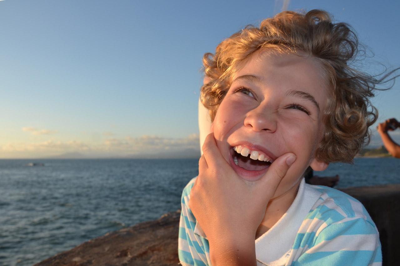 Boy laughing at funny joke