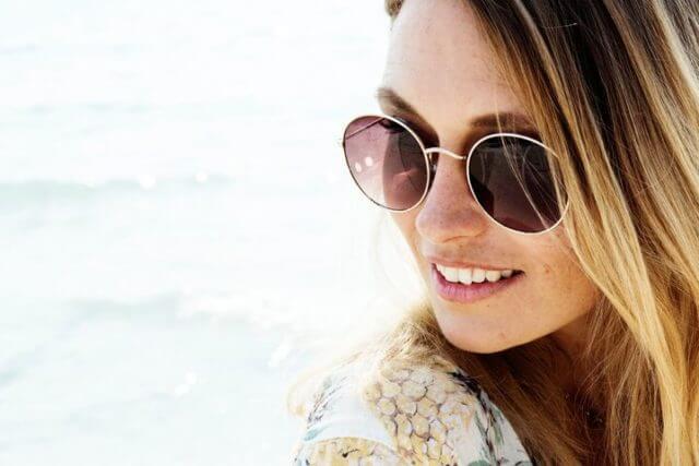 Woman wearing Vera Wang Designer Sunglasses