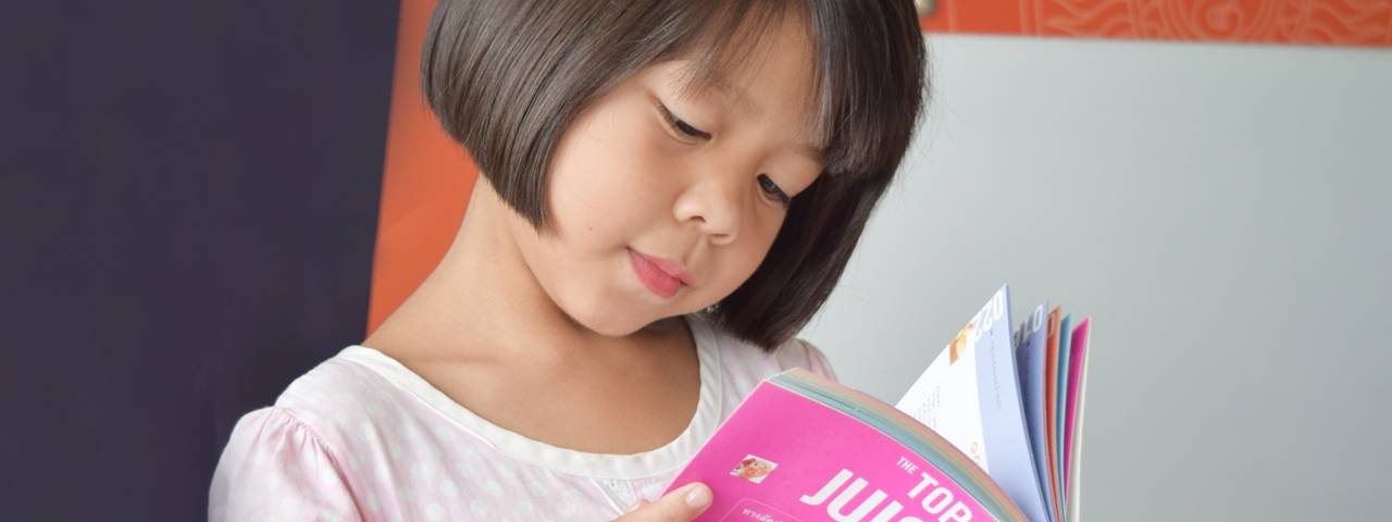 Gril Reading, Showing Importance of Pediatric Eye Care