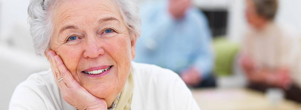 Older woman, after successful macular degeneration treatment