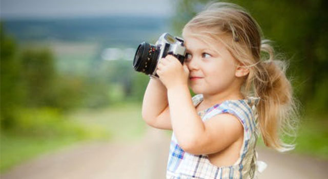child-taking-photograph