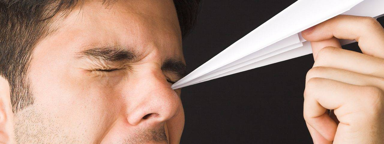 Man with sharp object in eye