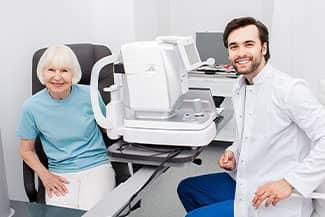 Smiling Optometrist low vision eye exam Thumbnail