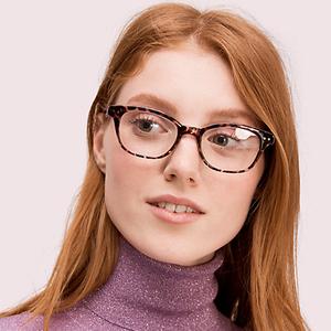 girl red haird wearing kate spade eyeglasses