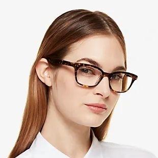 girl wearing brown rimmed kate spade eyeglasses