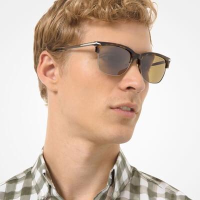 man wearing gold tinted michael kors sunglasses