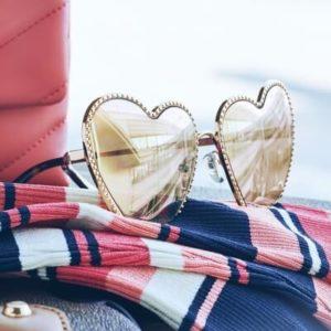 pair of heart shaped michael kors sunglasses