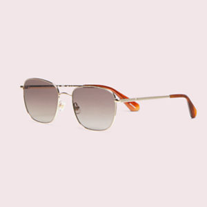 pair of kate spade sunglasses pink background