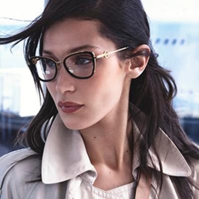 woman wearing michael kors black rimmed eyeglasses