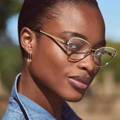 woman wearing michael kors eyeglasses