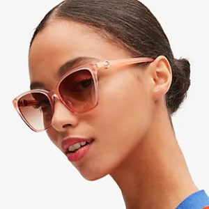 young woman wearing kate spade sunglasses