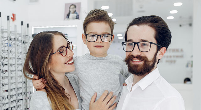 Family With Little Son In The Glasses Store