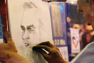 artist drawing man with no glasses.jpg
