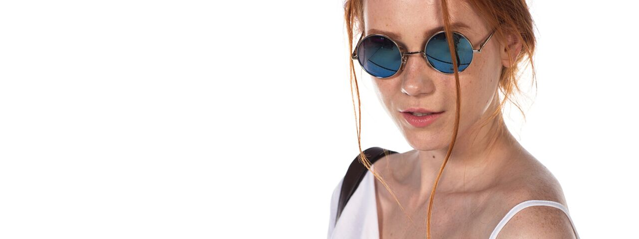 Woman Redhead Sunglasses at TotalVision in Connecticut