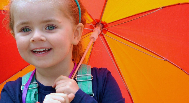 kid-with-umbrella-pediatric-eye-care.-Edmonton-AB-640x350-1
