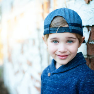 Girl wearing blue baseball cap 640 300x300