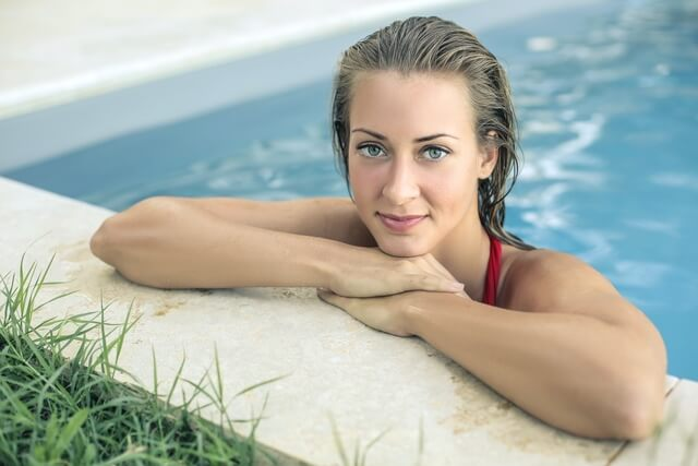 blue eyes girl in the swimming pool