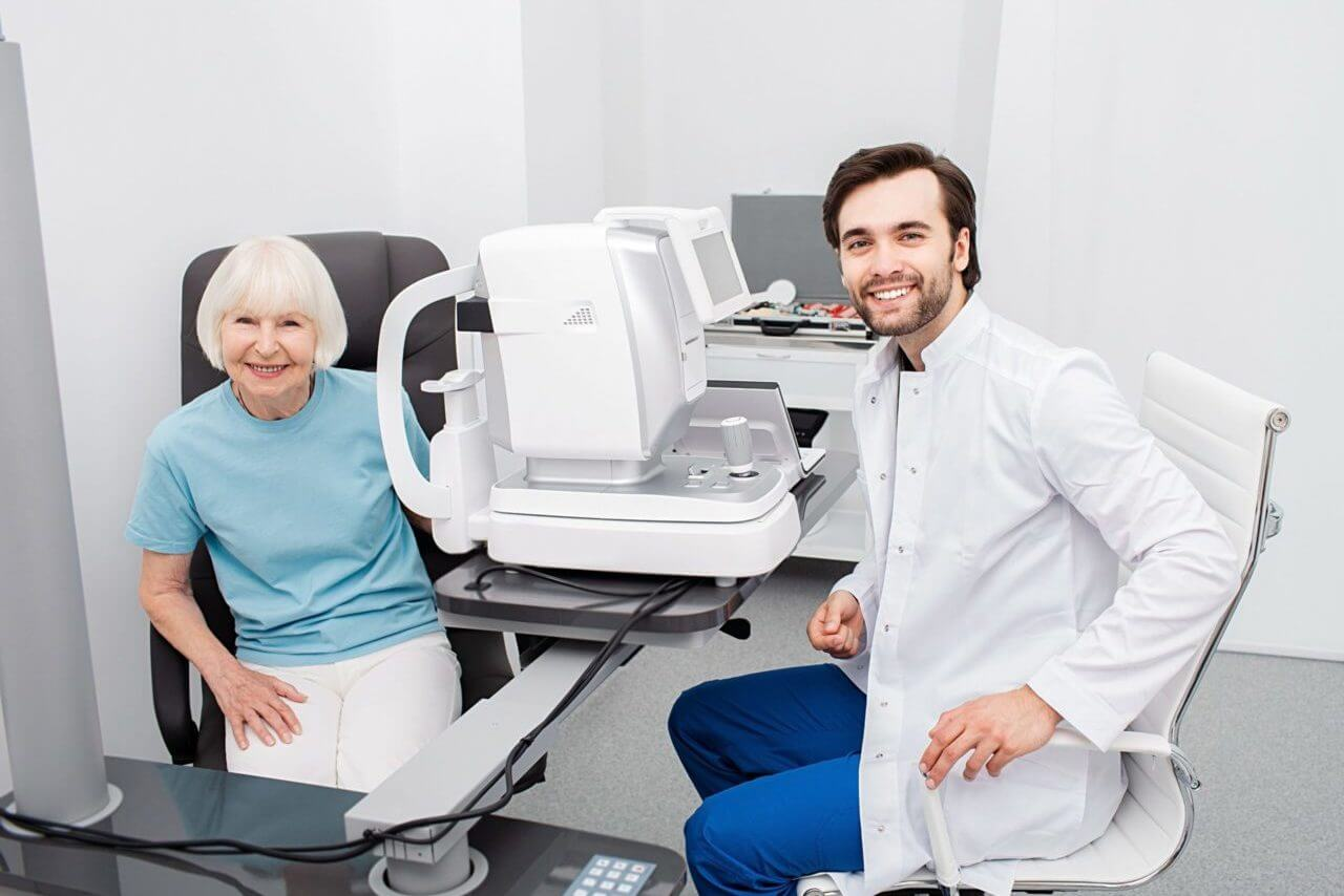 Smiling Optometrist With His Senior Patient, Friendly looking At