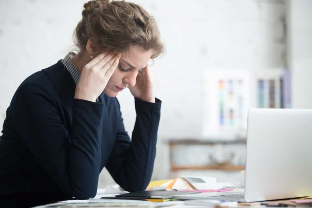 woman with headache and neck pain, digital strain in West Lebanon, NH