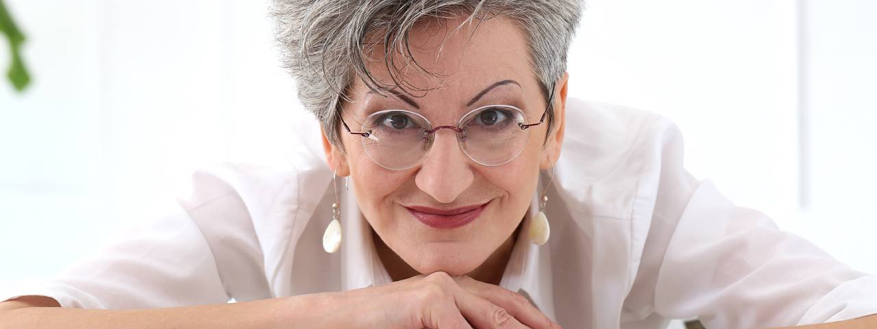 Woman wearing prescription glasses, Eye Care in Billings, Montana