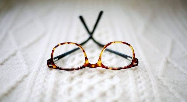 glasses on white sweater 640x350