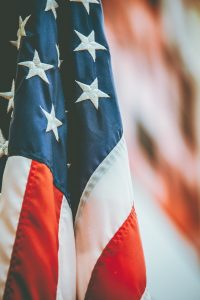 american flag todd trapani J4AjCmiCUos unsplash
