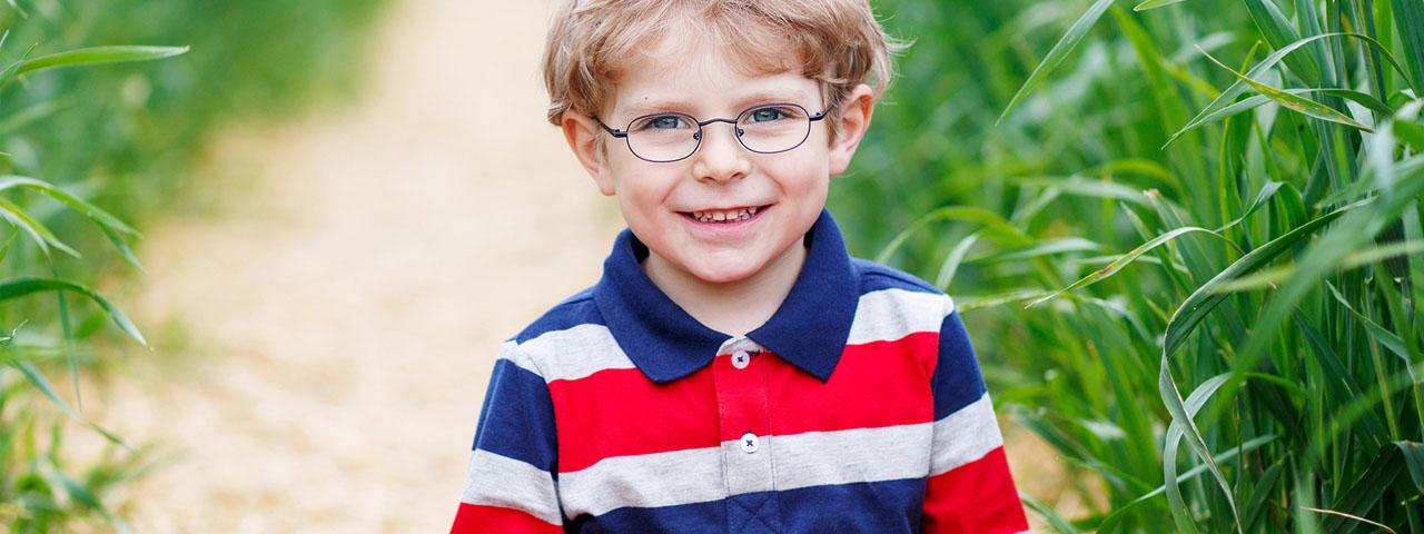 Boy-Smiling-in-Grass-1280x480