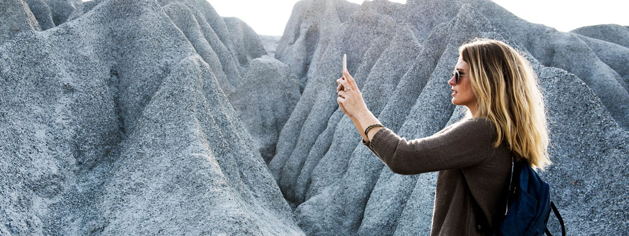 Woman-Mountains-Taking-Picture-1280x480