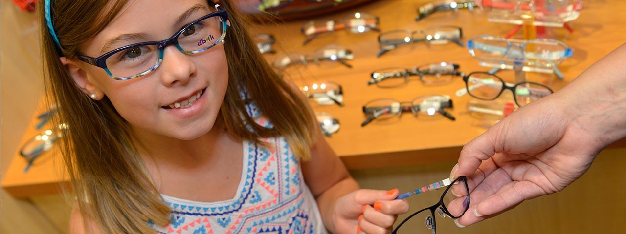 little-girl-trying-on-glasses-1280x480