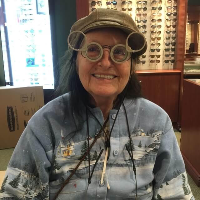 senior woman wearing low vision glasses
