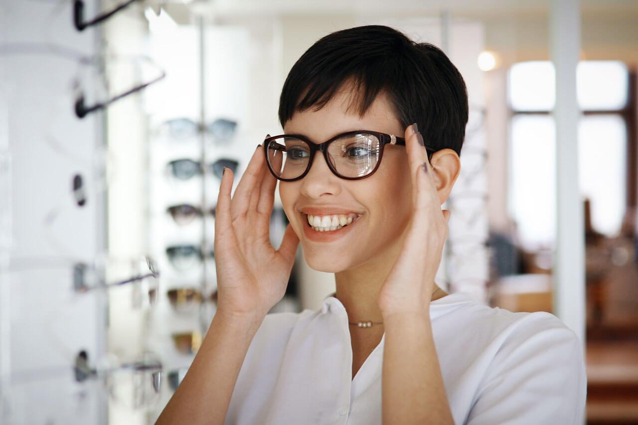 girl brunette glasses store smile 1280