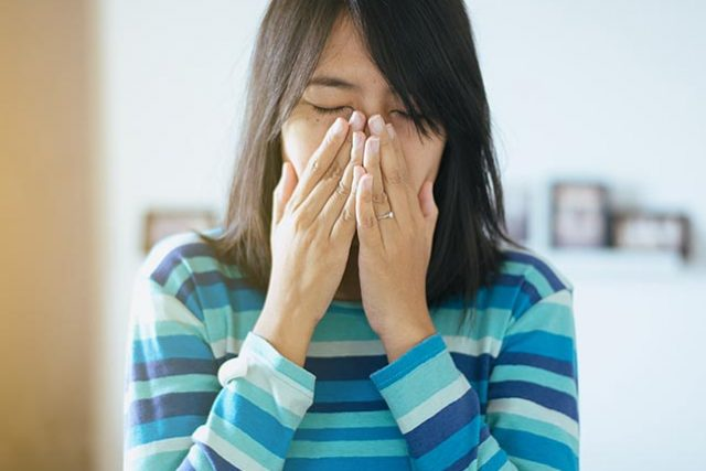 Optometrist, asian woman suffering from eye allergies in San Antonio, Texas