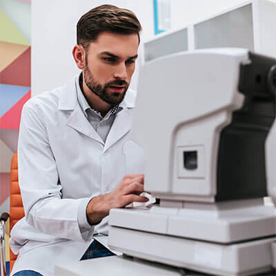 eye doctor looking at technology