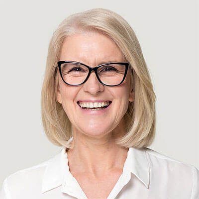 woman wearing black glasses and smiling