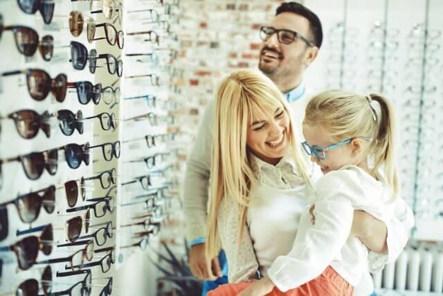 Caucasian Family Trying on Eyeglasses