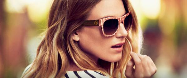 Woman wearing Tory Burch sunglasses